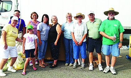 "The United Way Day of Action on June 21 provided food distribution through the Feeding America Mobile Food Pantry in LaRue County. Wal-Mart, Sam's Club and Kroger provided additional items; Kentucky Association of Food Banks provided produce through the Farms to Food Banks program. Volunteers assisted more than 200 families.   Volunteers pictured are Shirley and James ""Bud"" Eastridge, Layla Vertrees, Helen Miles, Chastity Walters, Alice Riggs, Maurcen Denham, Lois Richardson, Gary Miles and Danny Marcum. Not pictured: Amber Lyvers and Medley."