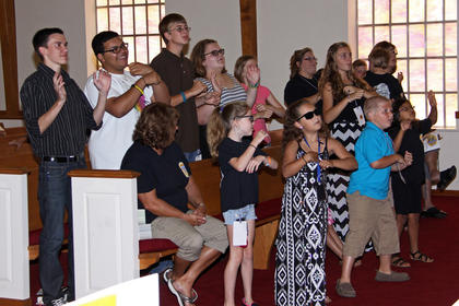 Children attending vacation Bible school at Buffalo Baptist performed a song. Front from left, Tina Hornback (seated), Shelby Ward, Madison Chaudoin, Isaac Childress, Lindsey Shelton, Bella Boster, and Tonya Boster holding Aiden Boster; second row, Jonathan Berry, Jordan Jones, Robert Absher, Taylor Skaggs, Alexandra Shelton, Christina Northenor and Thomas Shelton.