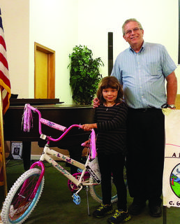 LaRue Baptist Church held vacation Bible school last week. Bro. Donald Kennedy is pictured with Amy Johnson who won the overall attendance drawing for a girl's bicycle.