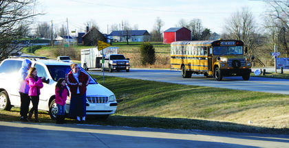 Families waited outside the fire house in Magnolia for the Santa bus.