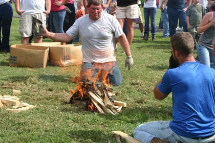 Tyler Adams (right) and Bill Thomas work on keeping their fire going during the water boil relay.