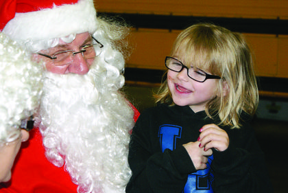 Willow Logsdon smiled at Santa.