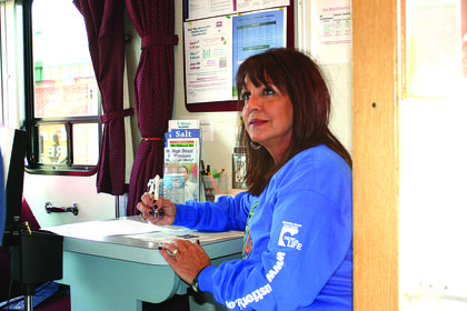 Coochie Routt filled out paperwork to have a checkup at Hardin Memorial Hospital's Wellness on Wheels.