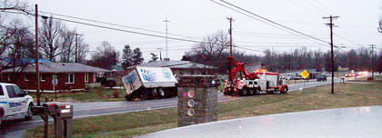 A milk truck spun around and overturned on KY 61, causing traffic to back up for several miles.