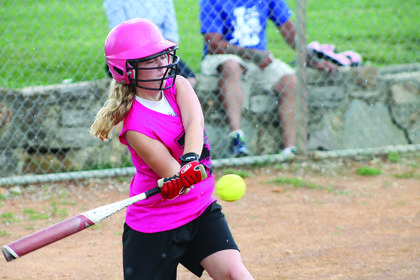 Hanna Seward gets a triple out of a big hit during a youth softball league tournament against Blue Heat.