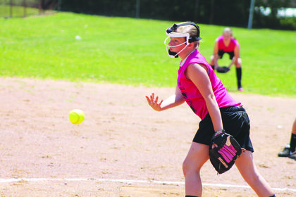 Shelby Williamson pitched in a youth softball league tournament for the Glitter Hitters. The team was tops in the league and placed second in the end-of-season tournament against the Slimers.