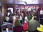 HES third graders sing for Rotary Club