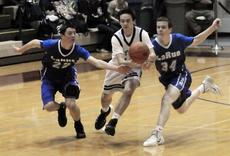 "<div class=""source"">Neal Cardin</div><div class=""image-desc"">LaRue County's Micah Wiseman, left, and Caleb Sheffer chase a loose ball with Elizabethtown's Jackson Gillock during Boys' 5th Region Tournament action Thursday night.</div><div class=""buy-pic""><a href=""/photo_select/33735"">Buy this photo</a></div>"