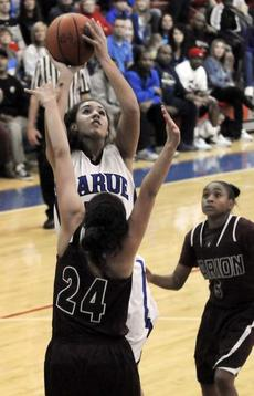 """<div class=""""source"""">Neal Cardin</div><div class=""""image-desc"""">LaRue County's Alexis Brewer shoots over Marion County's Ambrasia Adams during Saturday night's 5th Region Tournament semifinal action at Nelson County.</div><div class=""""buy-pic""""><a href=""""/photo_select/33781"""">Buy this photo</a></div>"""
