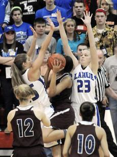 """<div class=""""source"""">Neal Cardin</div><div class=""""image-desc"""">LaRue County's Alley Evans, left, and Ivy Brown block the shot effort of Marion County's Alexus Calhoun on Saturday night. </div><div class=""""buy-pic""""><a href=""""/photo_select/33782"""">Buy this photo</a></div>"""