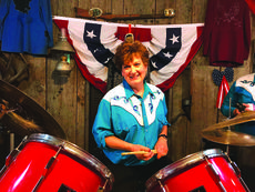 "<div class=""source""></div><div class=""image-desc"">Donna Richardson is the newest edition to the Lincoln Jamboree's Band. She is pictured  behind her drums in the classic Jamboree Attire.</div><div class=""buy-pic""><a href=""/photo_select/61162"">Buy this photo</a></div>"