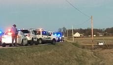 "<div class=""source"">The News Enterprise</div><div class=""image-desc"">A car involved in a police chase from Elizabethtown to Sonora in LaRue County is seen in a field off of Hwy 84. The suspect was shot and flown to University of Louisville hospital.</div><div class=""buy-pic""><a href=""/photo_select/62539"">Buy this photo</a></div>"