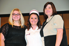 "<div class=""source""></div><div class=""image-desc"">Brittany Skaggs of Mount Sherman, middle, graduated from Campbellsville University's nursing program in December.  Skaggs was joined by her mother, Kim Skaggs, and sister, Bethany Skaggs, at the pinning ceremony. </div><div class=""buy-pic""><a href=""/photo_select/25179"">Buy this photo</a></div>"