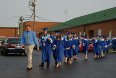 """<div class=""""source"""">Linda Ireland</div><div class=""""image-desc"""">Senior class adviser Rex Hanson leads the graduates toward the gymnasium. Behind him, valedictorian Andrew Skaggs gives a 'thumbs up.'</div><div class=""""buy-pic""""><a href=""""/photo_select/14734"""">Buy this photo</a></div>"""