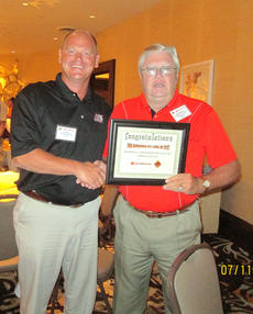 "<div class=""source"">Submitted photo</div><div class=""image-desc"">Donald McDowell, McDowell Farm Machinery of Hodgenville, was presented the 2012 Rhino BTL (Born to Lead) Award for the top dealer sales in Kentucky. He received the award in July at the Rhino Dealer Convention at the Grand Casino in Shelbyville, Ind.   </div><div class=""buy-pic""><a href=""/photo_select/29892"">Buy this photo</a></div>"