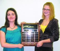 """<div class=""""source""""> </div><div class=""""image-desc"""">Hallie Madriaga and Meredith Heath had their names added to the Outstanding 4-H Members Plaque. Hallie earned the LaRue County 4-H Outstanding Junior Member Award and Meredith earned the Outstanding Senior Member Award for 2009. </div><div class=""""buy-pic""""><a href=""""/photo_select/8953"""">Buy this photo</a></div>"""