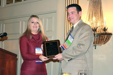 """<div class=""""source""""></div><div class=""""image-desc"""">Aaron LaRue was honored by his peers at the annual Independent Insurance Agents convention. The award was presented by Carolyn Reynolds Bogie of Berea, former chairperson of Independent Insurance Agents of Kentucky.</div><div class=""""buy-pic""""></div>"""