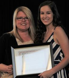 """<div class=""""source"""">Submitted Photo</div><div class=""""image-desc"""">Dianne's daughter Hope Ida presents the 3rd Annual Dianne """"Subbie"""" Ida Memorial Scholarship to the HES recipient, Abigail Hazelwood, at the LaRue County High School Awards Night.</div><div class=""""buy-pic""""><a href=""""/photo_select/64000"""">Buy this photo</a></div>"""