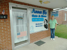 "<div class=""source"">Vanessa Hurst</div><div class=""image-desc"">Anna Brown stands next to her new window sign at her salon on South Walters Avenue.</div><div class=""buy-pic""><a href=""/photo_select/43448"">Buy this photo</a></div>"