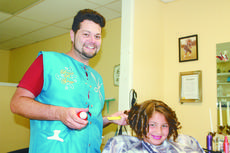 "<div class=""source"">Bobbie Lanham</div><div class=""image-desc"">Elise Cecil, 9, of Mt. Sherman recently got her hair styled by Daniel Skaggs at Best Little Hair House in Hodgenville. She and her sister, Elena, were getting their hair styled for annual birthday pictures. </div><div class=""buy-pic""><a href=""/photo_select/42670"">Buy this photo</a></div>"