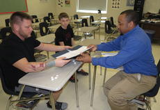 """<div class=""""source"""">Ron Benningfield</div><div class=""""image-desc"""">Agriculture teacher Chris Thomas, right, discusses classes to take at LaRue County High School with LaRue County Middle School eighth grade student Preston Carter and his father, Noah.</div><div class=""""buy-pic""""><a href=""""/photo_select/40820"""">Buy this photo</a></div>"""