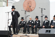 """<div class=""""source"""">Linda Ireland</div><div class=""""image-desc"""">The Lincoln Look-Alike Contest was held at 11 a.m. Saturday. Larry Elliott of Louisville spoke to the crowd.</div><div class=""""buy-pic""""><a href=""""/photo_select/30800"""">Buy this photo</a></div>"""