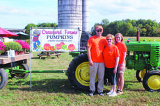 """<div class=""""source""""></div><div class=""""image-desc"""">Crawford Farms is located on 3999 Hodgenville Road in Elizabethtown near the LaRue/Hardin County line. The farm has several attractions for all ages and they also sell over fifty varieties of pumpkins, gourds, squash and other fall decorations. Shown above is the Crawford family from left: Mason Crawford, Shirley Crawford and Teresa Lee.</div><div class=""""buy-pic""""><a href=""""/photo_select/43884"""">Buy this photo</a></div>"""
