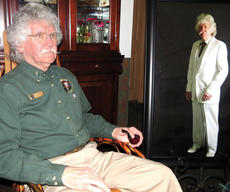 """<div class=""""source"""">Photo by Ron Benningfield</div><div class=""""image-desc"""">Curtis O'Dell, Mark Twain impersonator, sits beside a picture of himself in character as the late humorist.  O'Dell will perform 6:30 p.m. April 21 at the Hodgenville Woman's Club. </div><div class=""""buy-pic""""><a href=""""/photo_select/41236"""">Buy this photo</a></div>"""