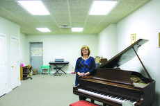 "<div class=""source"">Vanessa Hurst</div><div class=""image-desc"">Piano Instructor Diana Aubrey in her studio located at 112 S. Walters Avenue Suite 103 in Hodgenville. Aubrey offers piano instruction for all levels from beginner to college prep and for ages from 2 years old to adults. </div><div class=""buy-pic""><a href=""/photo_select/45581"">Buy this photo</a></div>"