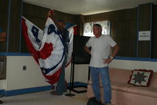 """<div class=""""source"""">Linda Ireland</div><div class=""""image-desc"""">City employees recovered American flag buntings from the fairgrounds.</div><div class=""""buy-pic""""><a href=""""/photo_select/36499"""">Buy this photo</a></div>"""