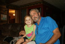 """<div class=""""source"""">Linda Ireland</div><div class=""""image-desc"""">Gary Rock snuggles with granddaughter, Taylor, 3.</div><div class=""""buy-pic""""><a href=""""/photo_select/30929"""">Buy this photo</a></div>"""
