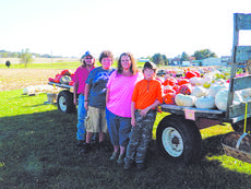 "<div class=""source"">Vanessa Hurst</div><div class=""image-desc"">From left, Eric, Levi, Becky and Wade Wilmoth, not pictured, Trent. Wilmoth's Pumpkins and More are located at 3521 Shepherdsville Road, Hodgenville. They offer a wide variety of pumpkins, gourds, and squash. They are open 4 p.m. until dark on week days and all day on Saturday and Sunday. </div><div class=""buy-pic""><a href=""/photo_select/44900"">Buy this photo</a></div>"