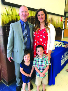 """<div class=""""source"""">submitted photo</div><div class=""""image-desc"""">Chris Price and his family.</div><div class=""""buy-pic""""><a href=""""/photo_select/59129"""">Buy this photo</a></div>"""