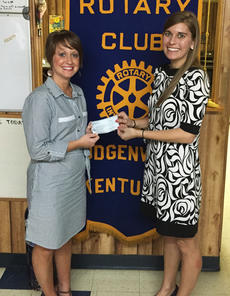 "<div class=""source""></div><div class=""image-desc"">Katie McDowell, left, on behalf of the Hodgenville Rotary Club, presented a $630 check to Amber Lyvers of Feeding America.</div><div class=""buy-pic""><a href=""/photo_select/41138"">Buy this photo</a></div>"