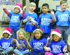 "<div class=""source"">Submitted photo</div><div class=""image-desc"">Students in Lauren Abbott and Tracy Tharp's classes sing ""Must Be Santa"" </div><div class=""buy-pic""><a href=""/photo_select/32319"">Buy this photo</a></div>"