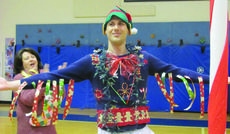 """<div class=""""source"""">submitted</div><div class=""""image-desc"""">Drew Simpson, physical education teacher, was the winner of Hodgenville Elementary School's first Ugly Sweater Contest.</div><div class=""""buy-pic""""><a href=""""/photo_select/38944"""">Buy this photo</a></div>"""