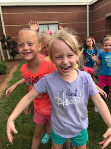 """<div class=""""source"""">Submitted Photo</div><div class=""""image-desc"""">Ayla Litton and Abby Creason enjoyed water games to celebrate the last day of Kindergarten!</div><div class=""""buy-pic""""><a href=""""/photo_select/63771"""">Buy this photo</a></div>"""
