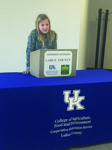 """<div class=""""source"""">Submitted photo</div><div class=""""image-desc"""">Kaylee Haycraft presented a speech on curing country hams in the 10 year old division. </div><div class=""""buy-pic""""><a href=""""/photo_select/59281"""">Buy this photo</a></div>"""