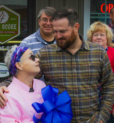 """<div class=""""source"""">Photo by Zackerie Fairfax</div><div class=""""image-desc"""">Kim Mather thanked Jim Shaw for his help in making Four Score a reality. Shaw owns the building the deli is located in. </div><div class=""""buy-pic""""><a href=""""/photo_select/63585"""">Buy this photo</a></div>"""