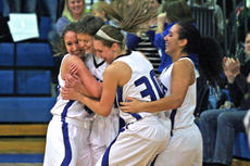"""<div class=""""source"""">Terry Sandidge</div><div class=""""image-desc"""">Senior Samantha Drake was congratulated by teammates after sinking a shot in Friday's game.</div><div class=""""buy-pic""""><a href=""""/photo_select/33406"""">Buy this photo</a></div>"""