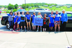 """<div class=""""source"""">Photo by Ben Loyall</div><div class=""""image-desc"""">Honor Roll students from the 4th and 5th grades. From the left are: School Secretary Esther Wolford, Danielle Bailey, Danny Bailey, Cyrus Bivens, Bridget Faulkner, Samuel Baumgarder, Morgan Skaggs, Trace Baumgardner, Blake Perez, Addison Skaggs, and ALES Principal Crystal Wilkerson. </div><div class=""""buy-pic""""><a href=""""/photo_select/63765"""">Buy this photo</a></div>"""