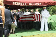 """<div class=""""source"""">Photo by Ben Loyall</div><div class=""""image-desc"""">An American flag was draped over the casket.</div><div class=""""buy-pic""""><a href=""""/photo_select/64006"""">Buy this photo</a></div>"""