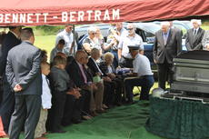 """<div class=""""source"""">Photo by Ben Loyall</div><div class=""""image-desc"""">The flag was properly folded before it was presented to Pickerell's family.  </div><div class=""""buy-pic""""><a href=""""/photo_select/64007"""">Buy this photo</a></div>"""