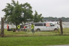 """<div class=""""source"""">Photo by Zackerie Fairfax</div><div class=""""image-desc"""">LaRue County Detention Center inmates are pictured helping clean the fairgrounds in preparation for the fair.</div><div class=""""buy-pic""""><a href=""""/photo_select/64491"""">Buy this photo</a></div>"""