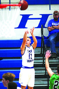 "<div class=""source"">photo by Terry Sandidge</div><div class=""image-desc"">Noah Davis is pictured shooting a three pointer. He was hot from the three point line during the game against East Jessamine as he hit two three pointers in the first quarter to put the Hawks ahead 14-13 at the end of the quarter. </div><div class=""buy-pic""><a href=""/photo_select/56766"">Buy this photo</a></div>"