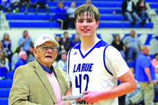 "<div class=""source"">photo by Terry Sandidge</div><div class=""image-desc"">Corky Cox is pictured presenting the Corky Cox MVP trophy for boys basketball to Mark Goode. </div><div class=""buy-pic""><a href=""/photo_select/56767"">Buy this photo</a></div>"