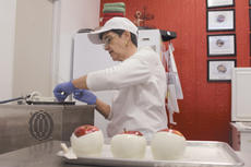 """<div class=""""source"""">Photo by Doug Ponder</div><div class=""""image-desc"""">MAM Candy owner Rooney Gray is shown making candy apples at her store. Gray's family has been making homemade candy for several decades and she uses her grandmother's recipes in her shop.  </div><div class=""""buy-pic""""><a href=""""/photo_select/42548"""">Buy this photo</a></div>"""
