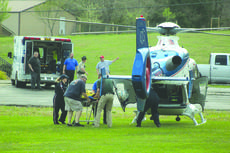 """<div class=""""source"""">Doug Ponder</div><div class=""""image-desc"""">The suspect in an officer involved shooting is pictured being loaded into a helicopter to be airlifted to the University of Louisville Hospital. The suspect is listed in serious condition. LaRue County Sheriff Russell McCoy said the deputy who fired the shots is currently on paid administrative leave.</div><div class=""""buy-pic""""></div>"""
