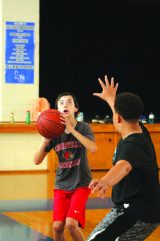 """<div class=""""source"""">Kaylan Anderson</div><div class=""""image-desc"""">Gabe Crim shooting against Jameison Belton in the 2018 Future Hawk Basketball camp. </div><div class=""""buy-pic""""><a href=""""/photo_select/59577"""">Buy this photo</a></div>"""