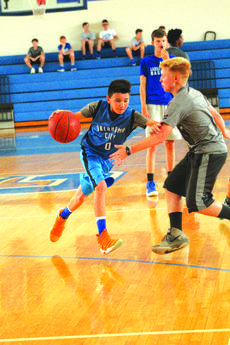"""<div class=""""source"""">Kaylan Anderson</div><div class=""""image-desc"""">Landon Blakey driving to basket in the 2018 Future Hawk Basketball camp. </div><div class=""""buy-pic""""><a href=""""/photo_select/59585"""">Buy this photo</a></div>"""